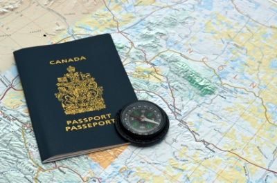 Passport, map and compass for planning a trip