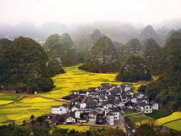 Синьи, Китай
